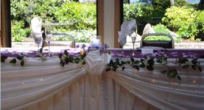 wedding head table flowers: garland