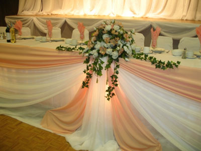 orange-pink theme flowers at wedding head table