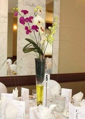 Floral vase wedding centerpice: orchid flowers