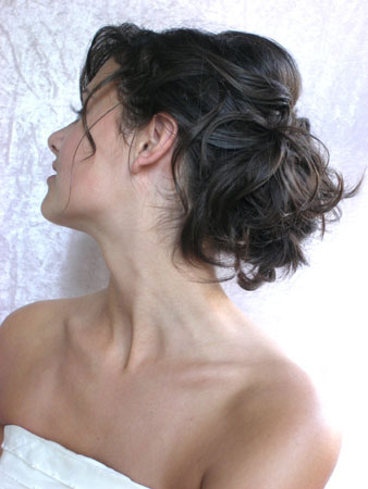 A messy updo bridal hairstyle