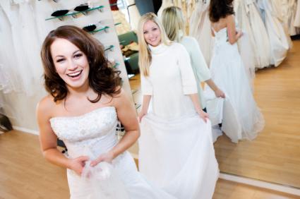 bride & friend in wedding boutique